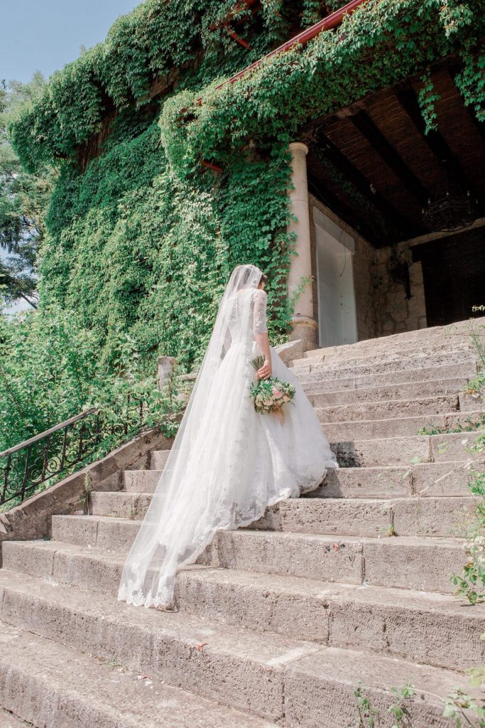 bride going up stairs to wedding