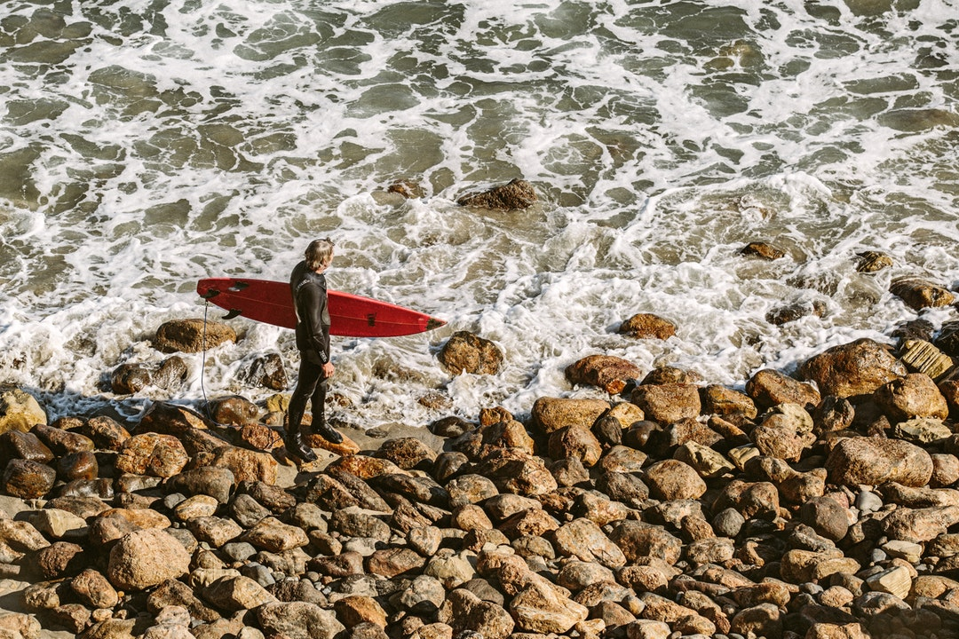 man getting ready to surf